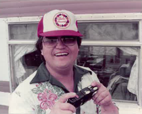 Jerry smiling in front of mobile home first cabin